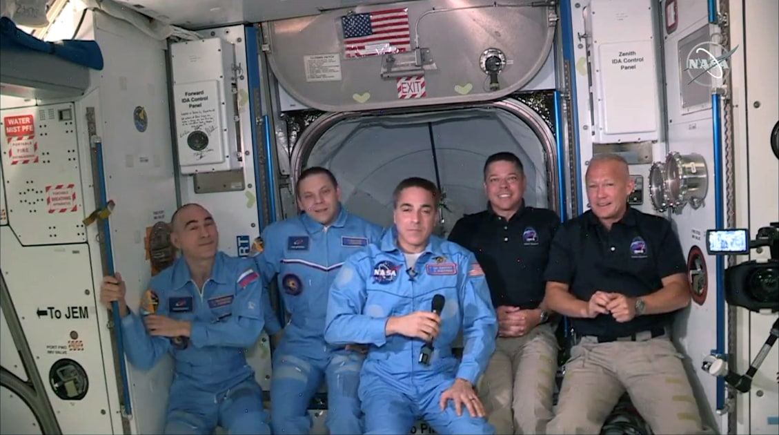 astronauts board the International Space Station