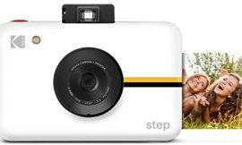 Kodak Step Camera Instant Camera with 10MP Image Sensor, ZINK Zero Ink Technology, Classic Viewfinder, Selfie Mode, Auto Timer, Built-in Flash & 6 Picture Modes   White.